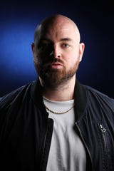 DJ Corbett, of Florence, photographed in the Enquirer's photo studio on January 16. Corbett is nominated for a Grammy in the Best Rap Song category for 'Racks in the Middle' as part of a collaboration.