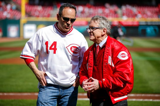 Kentucky Gov. Matt Bevin, left, and Ohio Gov. Mike DeWine meet on the field before an opening day baseball game between the Cincinnati Reds and the Pittsburgh Pirates, Thursday, March 28, 2019, in Cincinnati. (AP Photo/Gary Landers)