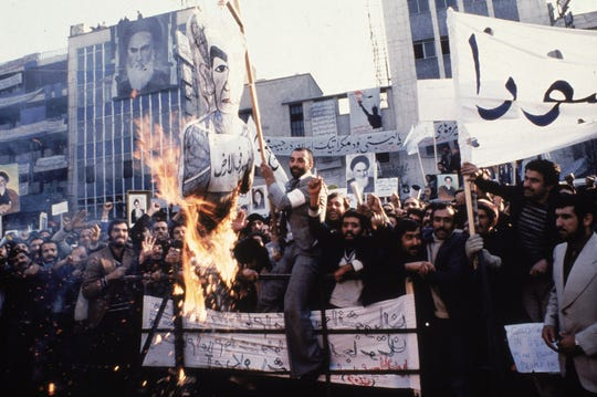 Protesters burn an effigy of Shah Mohammad Reza Pahlavi during a 1979 demonstration outside the U.S. Embassy in Tehran, Iran.