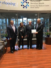 William DiStanislao, vice president, Operations; Jane O'Rourke, chief nursing officer; James Barna, director, Pharmacy and Thomas Shanahan, chief hospital executive, Raritan Bay Medical Center, gather together in recognition of the Bronze Steward Award by the New Jersey Department of Health.