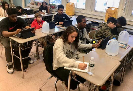 Students in Michael D'Amato's class at Soehl Middle School in Linden on Thursday, Jan. 9, taking part in a class discussion about a water crisis in developing nations that prevents girls their age from going to school.
