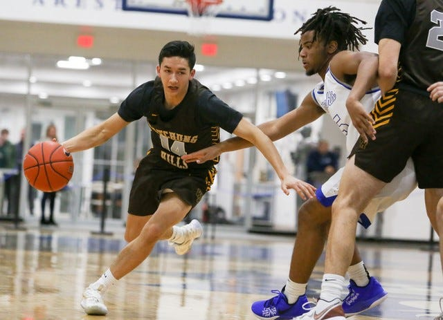 Watchung Hills' Brian Hopwood (14) looks to get around Gill St. Bernard's Isaac Hester (right) during their game on Thursday, Jan. 16, 2020.