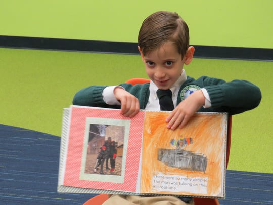 Levi Ziering of Scotch Plains proudly displays the book he created at the Just Write Café publishing party.