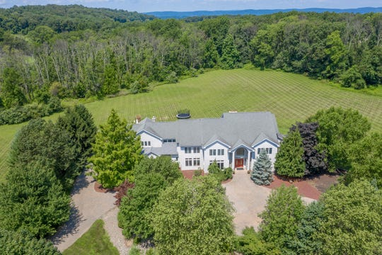 Situated on over six acres of landscaped property, a custom-built Colonialcentrally located about midway between Flemington and Clinton on a Franklin Township cul de sac is for sale for $724,900.