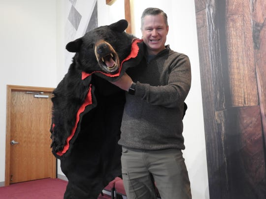 Pastor Neal Dearyan of Chili Crossroads Bible Church with a bear skin that will be on display at the church's annual Wild Game Dinner on Feb. 22. Proceeds benefit several ministries at the church, such as an addiction recovery program and youth activities.
