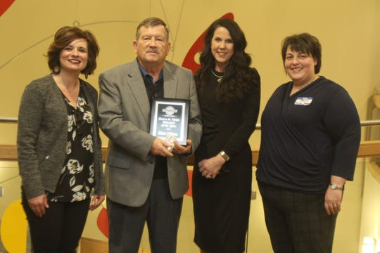 Volunteer of the Year Rick Wilson (second from left) poses with Indianola Chamber vice chair Heather Hulen, president Brenda Easter and Jennifer Pfeifer-Malaney. The Indianola Chamber of Commerce held their annual awards dinner on Jan. 16 at Simpson College's Kent Student Center.
