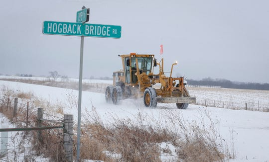 A Madison County grater clears snow off 195th Street in rural Winterset after a new round of winter weather dumped several inches of snow across much of central and northern Iowa on Friday, Jan. 17, 2020.