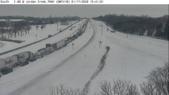 Traffic backs up after a crash occurred near Jordan Creek Parkway. Iowa is experiencing winter road conditions across the state.
