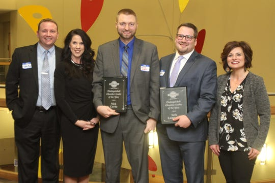 Indianola Chamber of Commerce board member Nate Fehl, president Brenda Easter and vice chair Heather Hulen (right) pose with Distinguished Chamber Leader Award winners Nick Carda and Seth Lampman. The Indianola Chamber of Commerce held their annual awards dinner on Jan. 16 at Simpson College's Kent Student Center.