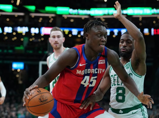 Detroit Pistons forward Sekou Doumbouya drives against Boston Celtics guard Kemba Walker in the second quarter at TD Garden on Jan. 15, 2020 in Boston.