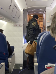 Police remove bags from a flight at Detroit Metro Airport on Thursday, Jan. 16, 2020 during a delay over concerns with a WiFi hot spot name.