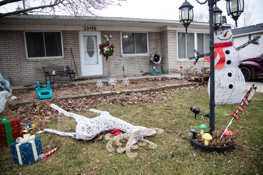 Fallen Christmas decorations lay in the front yard of Patricia Bennett Friday, Jan. 17, 2020 who was allegedly murdered by her 50-year-old daughter in their Roseville home.