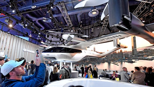 Flying cars and future cities among far-out tech at CES show