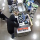 A video on the Facebook post appears to show a person in a black hoodie waiting as the worker touches a register screen in response to a request. When the till drawer opens, he pounces, pushing the employee out of the way as his hand dips into the drawer.
