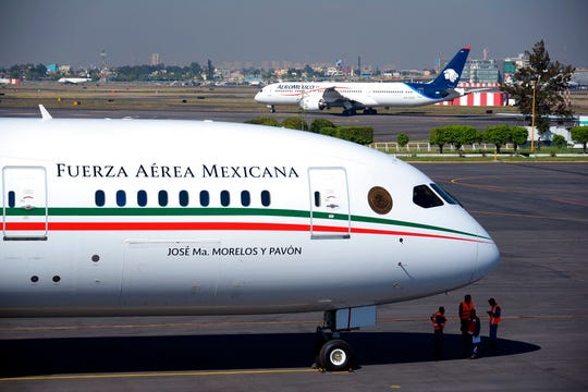 This Dec. 3, 2018 photo provided by the Mexican Presidential press office shows the presidential airplane at the presidential hangar at Benito Juarez International Airport in Mexico City.