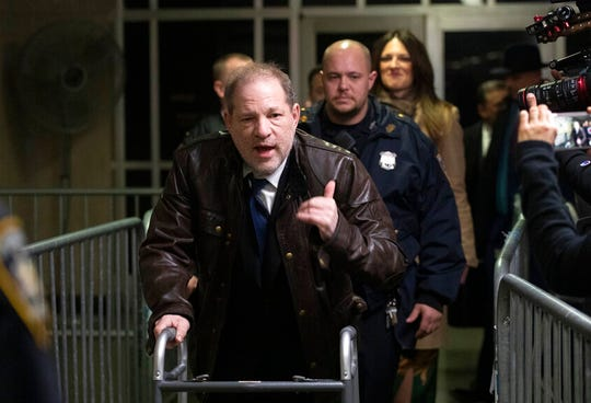 Harvey Weinstein gestures as he walks by reporters as he leaves a Manhattan courtroom after attending jury selection for his trial on rape and sexual assault charges, Friday, Jan. 17, 2020 in New York.