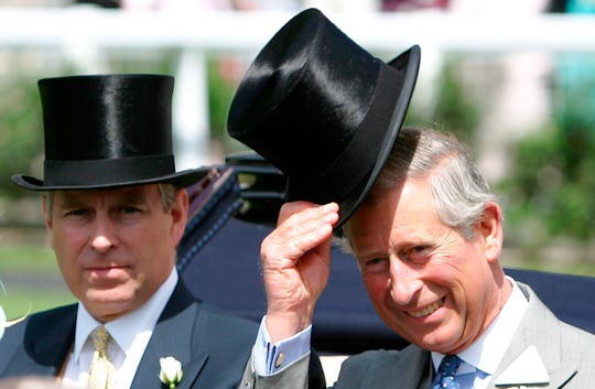 Britain's Prince Charles, right, with his brother the Prince Andrew the Duke of York as they arrive in the paddock for the Royal Ascot horse race meeting in 2006.