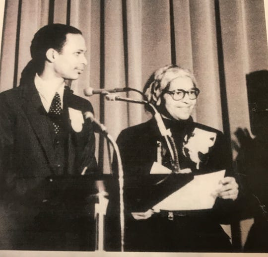 Mark S. Lee introduces Rosa Parks at an EMU function in January of 1982.