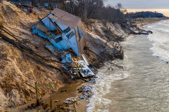 "Lake Michigan erosion claims Patricia ""Tish"" Gancer's beach house, pictured on Thursday, Jan. 2, 2020, in White River Township, near Montague, Mich."