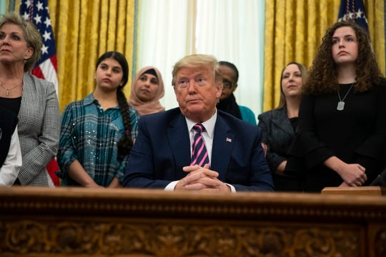 President Donald Trump listens to a question during an event on prayer in public schools, in the Oval Office of the White House, Thursday, Jan. 16, 2020, in Washington.