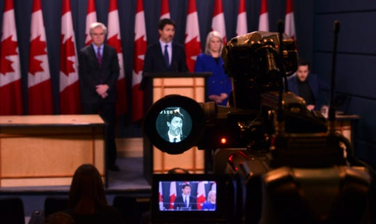 Canada Prime Minister Justin Trudeau, displayed in the viewfinder of a video camera, speaks a press conference at the National Press Theatre in Ottawa, Friday, Jan. 17, 2020.