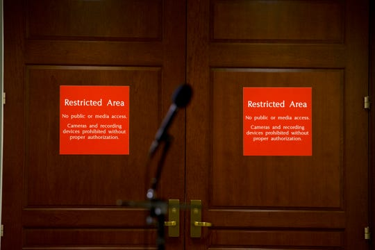 FILE - In this Nov. 15, 2019, file photo a microphone stands at the entrance to a secure area during a closed-door interview with David Holmes, a career diplomat and the political counselor at the U.S. Embassy in Kyiv, Ukraine, on Capitol Hill in Washington.
