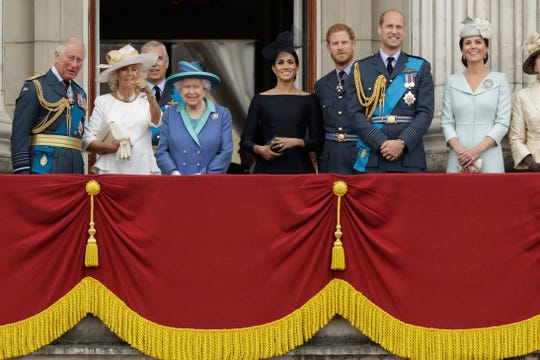 Members of the royal family gather on the balcony of Buckingham Palace, with from left, Prince Charles, Camilla the Duchess of Cornwall, Prince Andrew, Queen Elizabeth II, Meghan the Duchess of Sussex, Prince Harry, Prince William and Kate the Duchess of Cambridge, as they watch a flypast of Royal Air Force aircraft pass over Buckingham Palace in London on July 10, 2018.