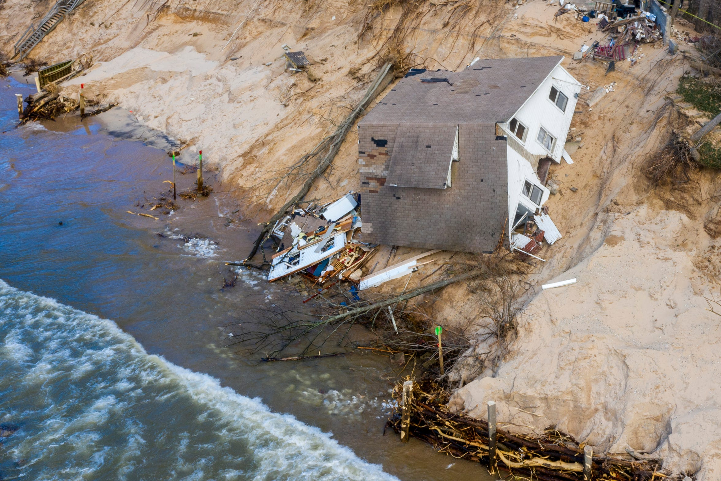 """Lake Michigan erosion claims Patricia """"Tish"""" Gancer's beach house, pictured on Thursday, Jan. 2, 2020, in White River Township, near Montague, Mich."""