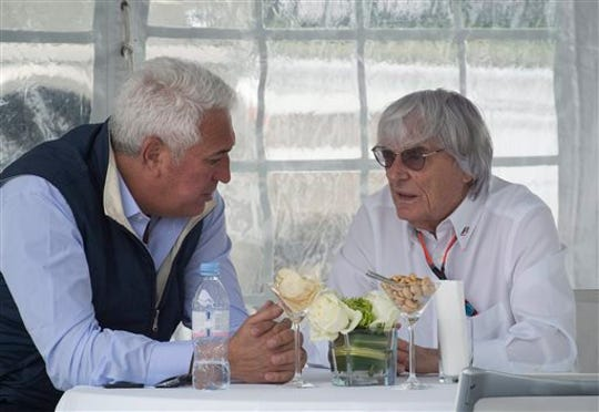 Montreal businessman Lawrence Stroll, left, talks with Formula One Group chief executive Bernie Ecclestone at the Canadian Grand Prix auto race in this June 7, 2015, file photo.