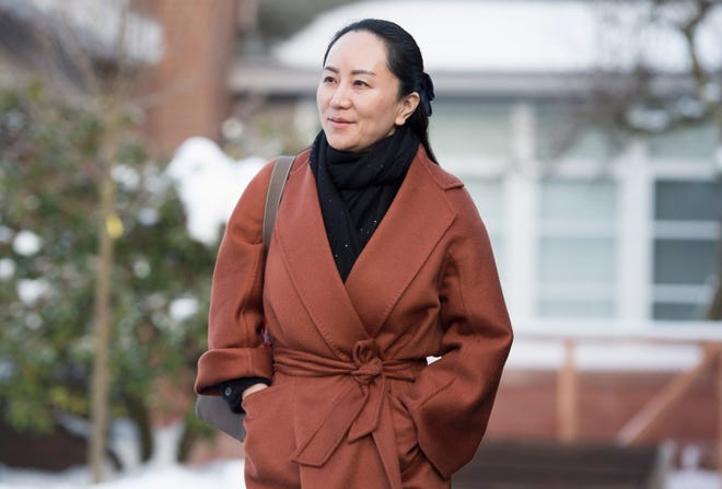 Huawei chief financial officer Meng Wanzhou, who is out on bail and remains under partial house arrest after she was detained last year at the behest of American authorities, leaves her home in Vancouver, British Columbia, Friday, Jan. 17, 2020, as she heads to B.C.