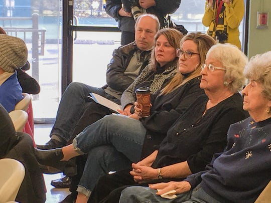 Constituents among a crowd of about 60 people at a coffee and conversation event in Washington Township Friday listen attentively to Michigan State Sen. Peter Lucido, R-Shelby Township,  January 17, 2020.