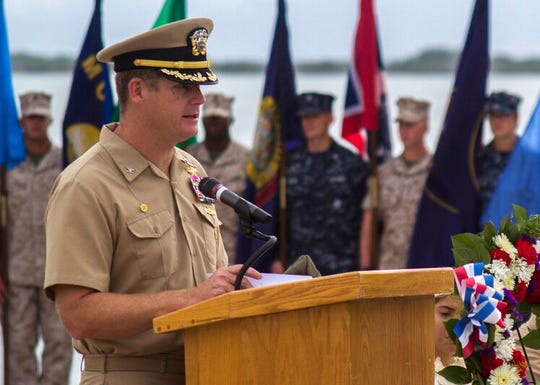 In this June 3, 2014, image provided by the U.S. Navy, Navy Capt. John R. Nettleton, then-commanding officer of Naval Station Guantanamo Bay, Cuba, speaks during a Battle of Midway commemoration ceremony.  Nettleton was convicted Friday, Jan. 17, 2020 of interfering with an investigation into the death of a civilian with whom the commander had fought and argued over his alleged affair with the man's wife.
