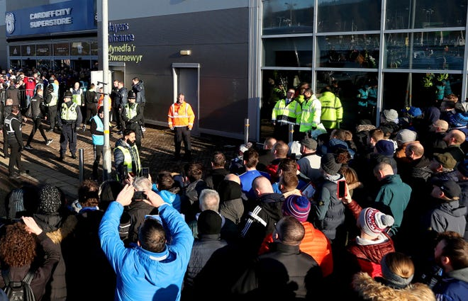 Soccer fans crowd outside the Cardiff City soccer stadium ahead of the English Championship match against Swansea City, in Cardiff, Wales on Jan. 12, 2020. The South Wales police deployed facial recognition surveillance equipment in a test to monitor crowds arriving for the weekend soccer match in real-time.