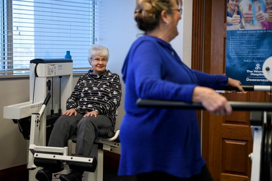 Diana Sander, left, and Karen Tackett, right, workout as they talk to Wellness Coach Rachel Moesner, not pictured, at the Deaconess Gateway Women's Hospital in Newburgh, Ind., Thursday morning, Jan. 16, 2020. The two women met in the FrameWorks program, which was designed for women who have or are at risk of osteoporosis.