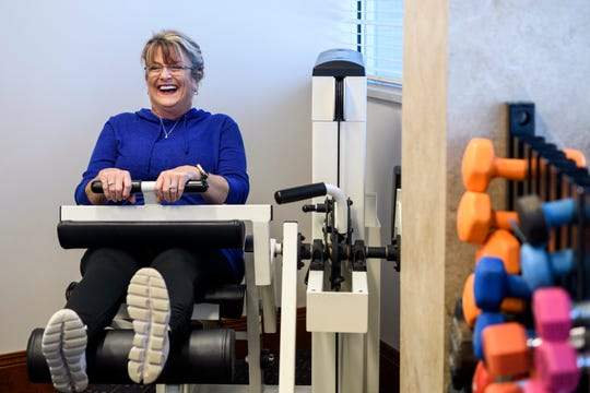 "Karen Tackett jokes around with Diana Sander and Wellness Coach Rachel Moesner, both not pictured, while using the leg curl machine inside the wellness center at the Deaconess Gateway Women's Hospital in Newburgh, Ind., Thursday, Jan. 16, 2020. "" I never would have done this, I definitely needed something like this class and the friendships I made here. We support each other,"" Tackett said."