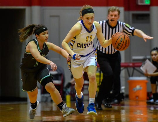 Castle's Carly Harpenau (11) brings the ball up under pressure from North's Maddie Haynes (1) as the Castle Knights play the North High Lady Huskies in the girls Southern Indiana Athletic Conference tournament semi-finals at Bosse High Thursday evening, January 16, 2020.