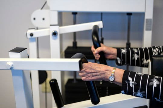 Diana Sander uses a weight machine inside the wellness center at the Deaconess Gateway Women's Hospital in Newburgh, Ind., Thursday morning, Jan. 16, 2020. She completed the 10-month FrameWorks program and continues to work out at the wellness center most Thursdays.