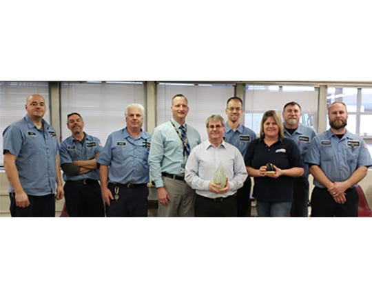 Postmaster General Sustainability Excellence Award presentation participants: Mechanic Jeff Braun, Mechanic Scott Carlile, Lead Mechanic Bradley Emge, Eastern Area Territory 5 Manager David Post, VMF Manager Tracey Tomes, Lead Mechanic Brian Martin,Storekeeper Kathy Hermann, Mechanic Jon Wolf, and Mechanic Nathaniel Lindsey. Not pictured: Mechanic James Deuerling, Mechanic Tim Tenbarge, and recently retired Mechanic Tim McGregor.