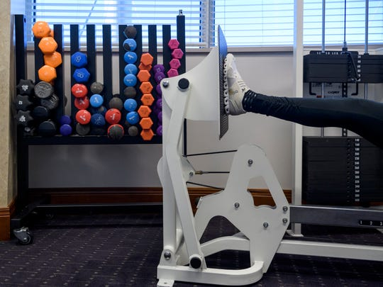 Karen Tackett uses the leg press machine during a weekly workout inside the wellness center at the Deaconess Gateway Women's Hospital in Newburgh, Ind., Thursday morning, Jan. 16, 2020. She completed the 10-month FrameWorks program and continues to work out at the wellness center most Thursdays.