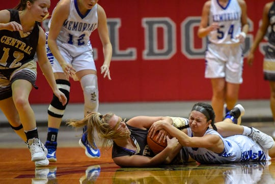 Central's Josie Jones (23) and Memorial's Mallory Russell (32) scramble for possession as the Memorial Tigers play the Central Bears in the girls Southern Indiana Athletic Conference tournament semi-finals at Bosse High Thursday evening, January 16, 2020.