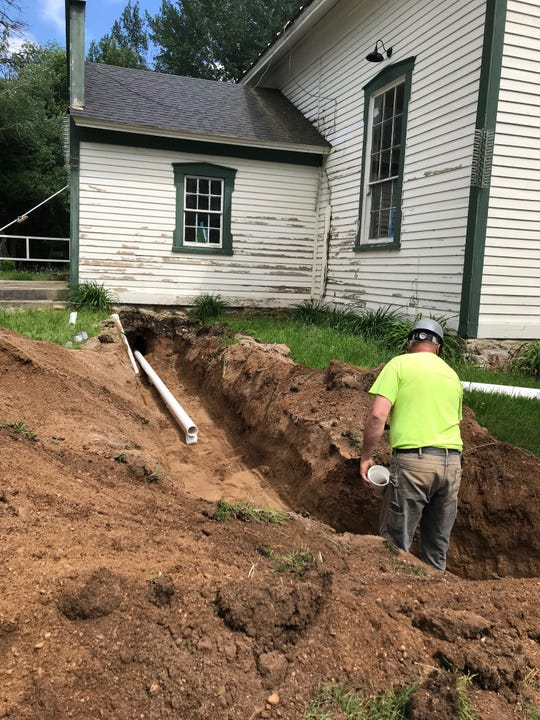 During the schoolhouse's renovation, a trench was dug for water lines between the new restrooms (formerly cloak rooms) and the sewer line on U.S. 151 in Calumetville