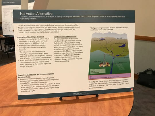Posters at a recent open house on the proposed expansion of Halligan Reservoir described alternative approaches to the project.