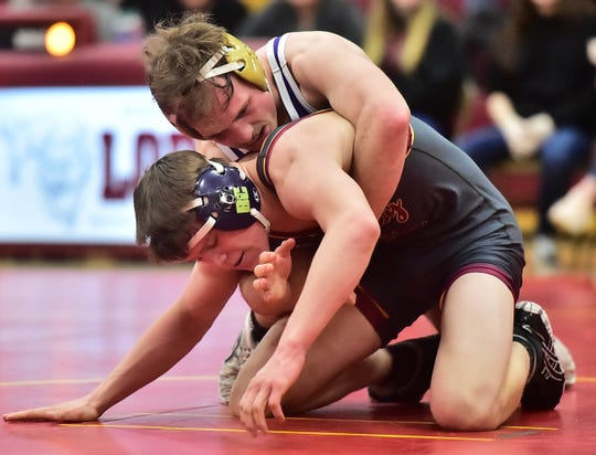 Fort Collins High School wrestler Joe Connor tries to remain in control at the start of a period while wrestling Rocky Mountain's Kolten Strait on Thursday, Jan. 16, 2020, in a dual match at Rocky Mountain. Strait won the match with a pin in 4:58.
