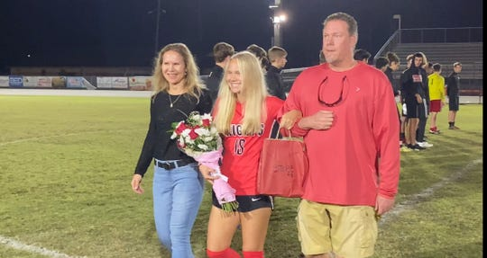 Emilee Hauser is honored on the North Fort Myers High School girls soccer team's Senior Knight on Thursday before breaking the program's career goal-scoring mark in a 16-0 win over Island Coast.