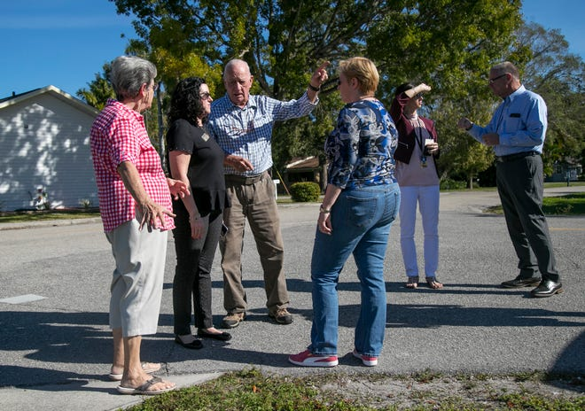 Neighbors near Allen Park Elementary School explain to Lee County School Board member Melisa Giovannelli, center, why a sidewalk should go on the side of the road that is closer to the school during a meeting with City Councilman Kevin Anderson, right, on Thursday, Jan. 16, 2020, in Fort Myers.