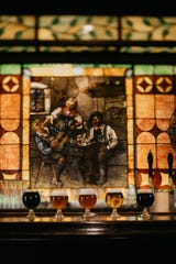 The stained glass bar back captures the spirit of McFleshman's Brewing taproom.