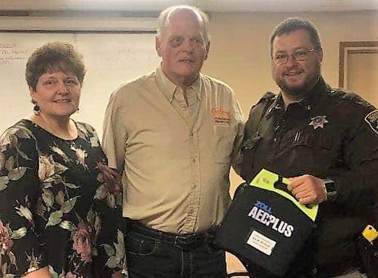 Dawn and Marvin Andree of Pound and Oconto County deputy Joe LeBreck, who used an AED to restart Andree's heart in May after he crashed on U.S. 41/141 in the town of Abrams. After learning LeBreck was the only deputy in the county to have and AED, Andrees and their family were spurred to raise money, which led to six additonal units being donated to the Sheriff's Office.