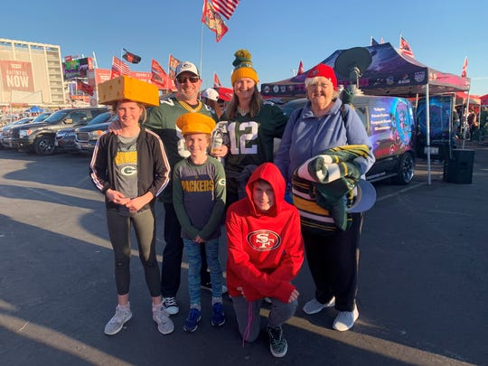 The Fisher family of Novato, Calif., poses for a photo outside Levi's Stadium before a 2019 NFL regular-season game between the Green Bay Packers and San Francisco 49ers. From left: Ellie, Jeff, Abby, Mariah, Wally and grandmother Dory Gresl.