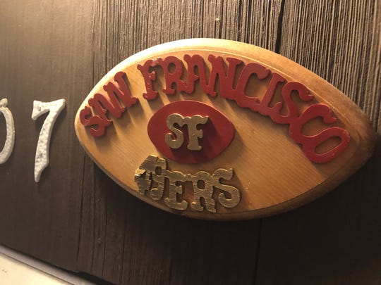 This sign bearing a San Francisco 49ers logo adorns the door of Dan and Jamie Bernhart's southwest Appleton home.