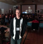 Door County Short Film Fest founder and Executive Director Chris Opper, with a screening taking place in Sister Bay Village Hall at a past festival.